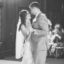 Bride Groom holding hands first dance black and white