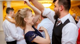 guy dancing with girl twirling her arm